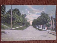 Reynoldsville-PA-Sunrise-on-Main-Street-Tinted-Printed-Photo-Postcard-1910