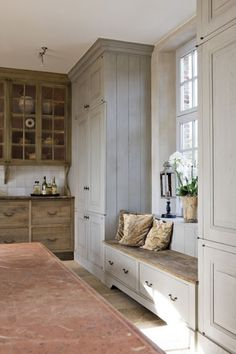 Built in cabinets and a window seat...needs a cushion but great idea for a kitchen window!