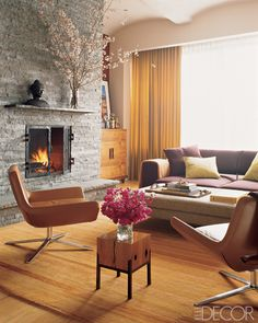 Modern Mix  Though sparsely decorated, the Manhattan living room of actors Rob Morrow and Debbon Ayer welcomes with a warm palette and a variety of textures. Center-cut pine floors are covered in a Tibetan-wool carpet by Odegard; the curtains are made of a Bergamo wool sateen, and organically shaped armchairs by B&B; Italia lend character to the space.