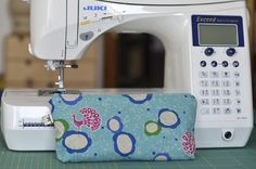 sewing machine notions storage pouch I made using echino (peacock) fabric and my beloved juki F600 :)