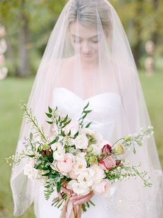 Vintage Bride with a Drop Veil and Peach Bouquet https://heyweddinglady.com/rustic-elopement-peach-summer-blue/ #wedding #weddings #weddingideas #elopement #engaged #summerwedding #bride #weddingdress #weddingdresses #veil #bouquet #bridalbouquet