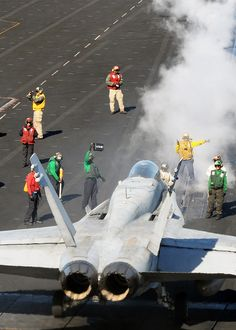 PACIFIC OCEAN (Nov. 11, 2012) Sailors prepare an F/A-18C Hornet assigned to the Death Rattlers of Marine Fighter Attack Squadron (VMFA) 323 to launch from the flight deck of the aircraft carrier USS Nimitz (CVN 68). Nimitz is currently underway participating in the ship's joint task force exercise (JTFEX). (U.S. Navy photo by Mass Communication Specialist 2nd Class Jacquelyn D. Childs/Released)