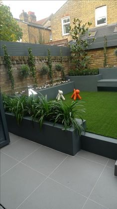 Raised beds grey colour scheme agapanthus olives artificial grass porcelain grey tiles Floating bench lighting Balham Wandsworth Battersea Vauxhall Fulham Chelsea London - Garden and Home Small Garden Landscape, Small Backyard Gardens, Modern Backyard, Backyard Landscaping, Landscaping Ideas, Patio Ideas, Small Patio, Creative Landscape, Rustic Backyard