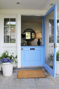 Light blue door welcoming you to a coastal home