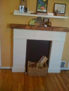 Simple Faux Fireplace White Wooden Mantel Also Rattan Box Storage Also Wooden Flooring And Sweet Brown Wall Painting Color Design