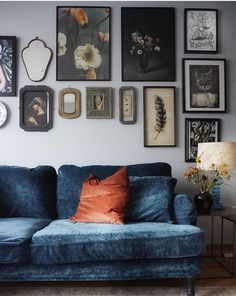 Stunning boho chic living room with a blue velvet howard sofa | eclectic wall gallery | IKEA Stocksund sofa with a Bemz cover in Sea Zaragoza vintage velvet