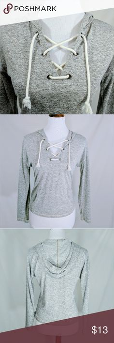 Drawstring Neckline Gray Hoodie NWOT Sexy or not laces on neckline of heather gray hoodie. Leave loose or tighten. Slim fit, front pocket.  Hood in back. New- no tags. Inspired Hearts brand. Inspire Tops Sweatshirts & Hoodies