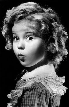 "At a time when Americans were weathering the tail-end of the Great Depression, child actress Shirley Temple Black was an unparalleled sensation. People not only flocked to her movies and bought Shirley Temple dolls, they also dressed their daughters in dresses and coats modeled after those she wore in the movie Dimples. ""Every girl 3 to 14 will want them,"" proclaimed a 1936 newspaper advertisement for a line of official ""Inspired by Shirley Temple"" outfits. The film credits of Shirley ..."