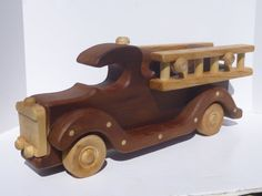 Handmade & Handcrafted from Beautiful, Recycled / Up-cycled natural Redwood. A wooden, toy fire engine that is High quality, hand crafted, &