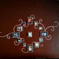 Wall clock with framed pictures.