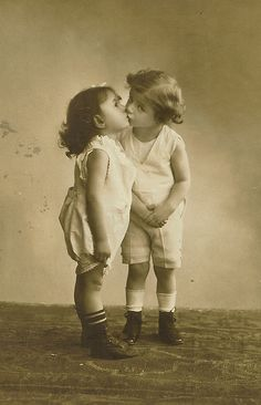 Vintage photo of kids kissing.