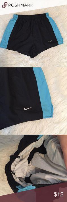 Nike Athletic Shorts Black athletic shorts with blue side stripes. Bloomers underneath. Size small. Nike Shorts