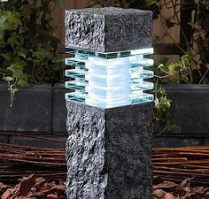 Techmar Garden Lights Phobos Rock Post Polyresin And Glass Diffuser Finished In Black £62.51  The Phobos has the appearance and almost the weight of rock made from poly resin and glass. It is a stone effect colour.