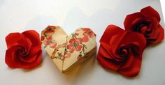 Two part origami heart box.  Paper used: old wrapping paper.  Tutorial here: http://www.youtube.com/watch?v=KEM8nRz83M8=relmfu