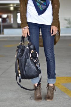 Skinny rolled up jeans, ankle boots, white tshirt, scarf, olive cardigan and oversized bag.