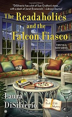 The Readaholics and the Falcon Fiasco: A Book Club Mystery by Laura DiSilverio http://www.amazon.com/dp/0451470834/ref=cm_sw_r_pi_dp_MgChvb05H5HRE