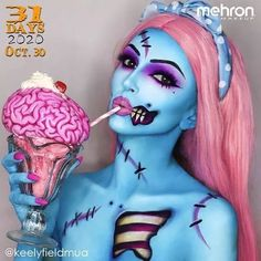 """October 30th finalist @keelyfieldmua Thanks to our friends at @MehronMakeup Artist Inspo: """"I really love colour and the vibrancy of pop art zombies has always appealed to me. I also just love how blue looks as skin so it had to be that but with some pink elements thrown in to compliment it. Oh and the brain milkshake was just a bit of fun!"""" Products used: Paradise Makeup AQ in Lagoon Blue Dark Blue Light Pink and White #mehronmakeup #zombie #popartzombie #zombiemakeup #popartzombiemakeup… Zombie Makeup, Halloween Face Makeup, Pop Art Zombie, Pop Art Makeup, Mehron Makeup, Blue Lagoon, Compliments, Body Art, Halloween Costumes"""