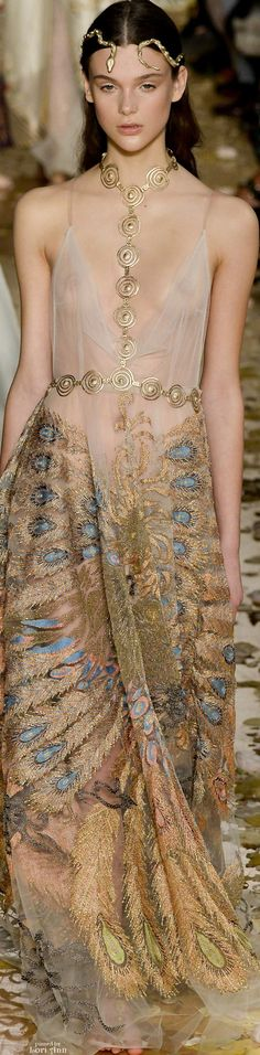 Valentino Couture Spring 2016  I like that they used the snake jewellery to make it into a headpiece which really goes with the spiral neck/waist piece.