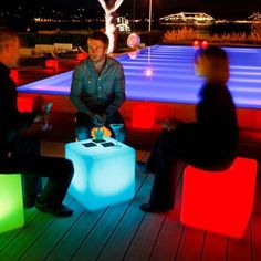 The lighted cube chair is an outdoor chair that is lighted up by an LED within the cube that comes with a remote control to turn the light within the chair on and off. The LED cube chair is battery po.