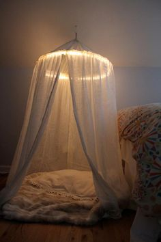 DIY Bedroom Furniture :DIY Canopy Bed : DIY play tent (with lights) // I HAVE ONE OF THESE! Diy reading nook: 1) get chair and put in selected area in bedroom. 2) put canopy on ceiling directly over chair. 3) line canopy with lights. 4) cover chair in blankets.