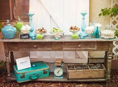 dessert table with vintage suitcase, kitchen scale and soda crate