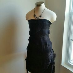"""NEW YORK & COMPANY..STUNNING...L..B........DRESS ...GREAT CONDITION  ...NORMAL WEAR  ...NO FLAWS ...STUNNING  ...true to it size and color  ...2 pic up close ...short dress ...TIGHT... on body ...strapless  ...lace design ...design troughout ....ruffles on front ....zipper on side.. ....MTRL...60%rayon 40%nylon ....LINING  95% polyester 5%spandex  ....DECORATION. ..100%polyester  ....DRY CLEAN ONLY.  ....LENGTH. ..31"""" ....better in person New York & Company Dresses Strapless"""