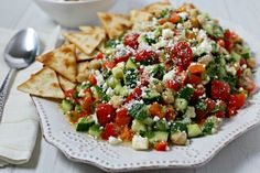 This chic and delicious Middle Eastern Chickpea Salad from CookingInStilettos.com is packed with protein-packed chickpeas and fresh veggies tossed in a lemon basil vinaigrette. This easy salad can be served as a side dish, main entree or even nestled in pita bread for the perfect lunch on the go   @CookInStilettos Easy Recipe   Vegetarian   Salad   Chickpea   Barefoot Contessa