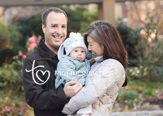 Photo of Six month old baby and parents in lower Manhattan taken by New York Baby Photographer Tara McGlinchey.