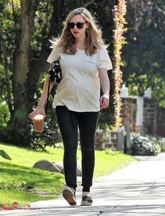 Pregnant actress Amanda Seyfried and her dog Finn stop by a hair salon in West Hollywood, California on February 9, 2017. Afterwards Amanda stopped for an iced coffee before heading home.