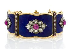 An antique ruby, diamond and enamel bracelet, circa 1880 composed of oval and circular-shaped star and cat's eye ruby cabochons accented by single-cut diamonds and rubies