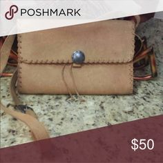 Handmade leather cross body Beautiful handmade leather cross body and it's truly one-of-a-kind. Used it for a few months after purchasing it but has been tucked away in my  closet for a long time now so time to let her go! Bags Crossbody Bags