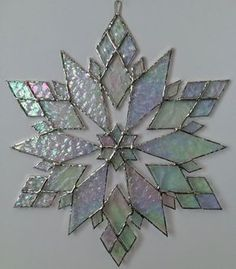 stained glass snowflake suncatcher design 21 by bitsandglassart Stained Glass Ornaments, Stained Glass Christmas, Stained Glass Suncatchers, Faux Stained Glass, Stained Glass Lamps, Stained Glass Designs, Stained Glass Panels, Stained Glass Projects, Glass Christmas Ornaments