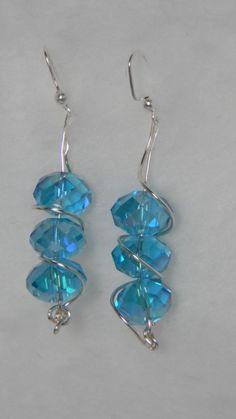 Twisted crystal earrings  $15.95 usd