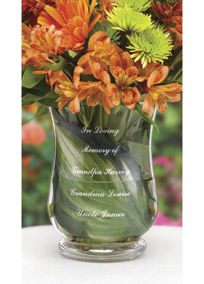 "Personalize this vase with three names of loved ones and fill the vase with flowers or a candle for a beautiful display of love and remembrance. The vase has three lines for personalization following ""In Loving Memory of"". Each of the three lines is engraved with a loved one's name, up to 24 characters including spaces.  Measures: 5 3⁄4"" diameter, 7 3⁄4"" tall."
