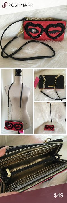 """Betsey Johnson wallet on a string clutch eyes wink Betsey Johnson ziparound wallet on a string clutch shoulder bag ✨ strap has 24"""" drop and is detachable ✨ gorgeous red quilted faux leather with black sequins and Crystal eye wink  wallet has 8 credit card slots, Photo ID slot, zippered coin pocket, two compartments and two wall pockets ✨ 8"""" x 4"""" easily fits iPhone 6 plus ✨ gorgeous  Betsey Johnson Bags Wallets"""
