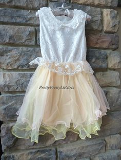 Pretty Pretty Lil Girls  Little Girls Pink - Yellow and Peach Princess Dress High Quality Cottton Tank Dress which is accented with a collared Lace  Bodice and is also Made with Very High Quality Thick Lined Lace that also ruffles the waist line...so cute ! The Bottom Skirt has many layers of ...