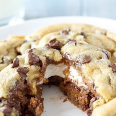 Giant S'mores Stuffed Chocolate Chip Cookies Recipe Afternoon Tea, Desserts with all-purpose flour, baking soda, salt, unsalted butter, brown sugar, granulated sugar, egg yolks, large eggs, vanilla extract, semi-sweet chocolate morsels, cookie dough, graham crackers, marshmallows, cookies