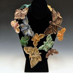 A real see it across the room piece. A beaded butterflies necklace. One of a kind fabulous wearable art by Huib Petersen.  http://www.pismoglass.com/artist.php?cat=j