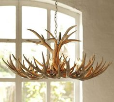 """Django Unchained: Nothing says """"outlaw"""" like a faux antler chandelier ($999)."""