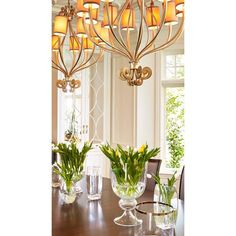 There is a power that lies in the spaces between. A composition of vases, some filled with tulips and others left to sparkle alone with gold rims and cut crystal, defines a delicate choreography of positive and negative space within our luxury dining room. #reginasturrockdesigninc #positiveandnegativespace