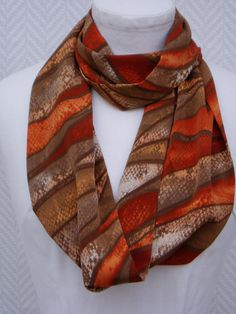 2b6d1d413587 Echarpe , snood, ethnique orange marron en polyester   Echarpe, foulard,  cravate par