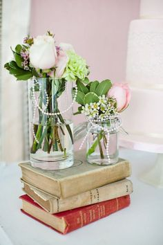 A great idea for a centerpiece- a stack of books (you know you have plenty) with some flowers. Cheap, unique, and low enough so people will be able to talk across the table to each other.