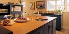 Richlite.  100% recycled paper countertop.  Install and repair with standard woodworking tools. Better color variety than Paperstone.