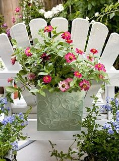 Planter hanging on the back of an outdoor chair – Love this :)