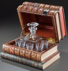 """""""I'll drink to that - faux stack of books holds a century French Baccarat decanter - via Book Furniture, Home Libraries, Stack Of Books, Geek Decor, Book Gifts, Nerd Gifts, Classic Books, Book Nerd, Decoration"""