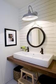 Bathroom with barn light, shiplap, cool vanity