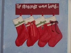 How To Hang Stockings Without A Mantle. -- hot glue clothesline & paint red with green dots
