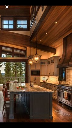 Love the huge kitchen island with build in seating. Like the hood vent. Like the backsplash.