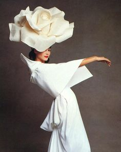 Christy Turlington in a giant rose hat and architectural robe. By Patrick Demarchelier.