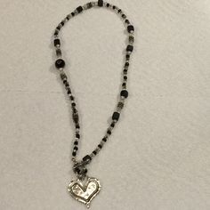 Beautiful Toggled Heart Necklace Beautiful Toggle a heart Necklace. 16 inch. Lovely beading . Black , grey, clear. Jewelry Necklaces